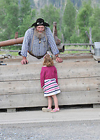 Prospector chatting with inquisitive child at Fort Steele Heritage Town in southeastern British Columbia..