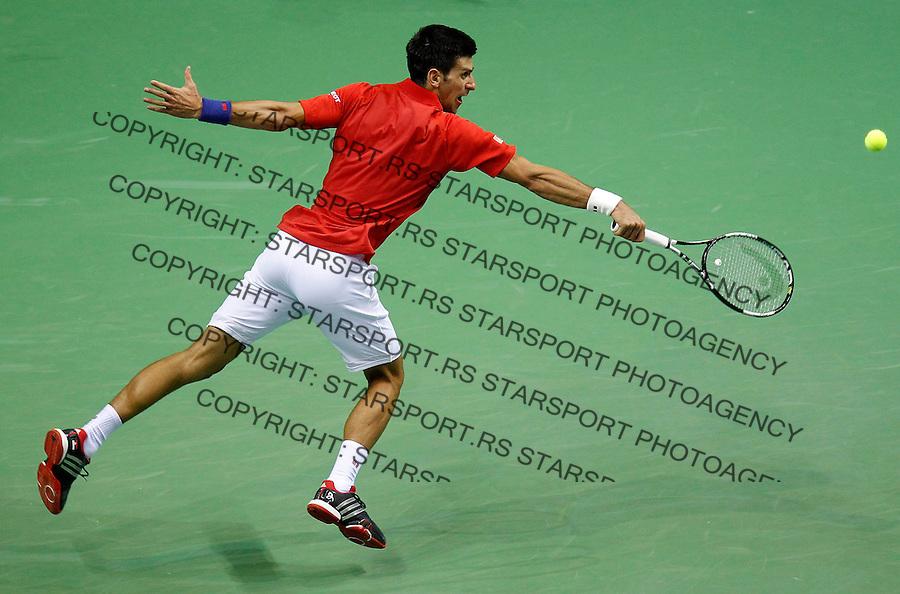Davis Cup 2014 first round<br /> Srbija v Hrvatska<br /> Novak Djokovic (SRB) v Mate Delic (CRO)<br /> Novak Djokovic in action<br /> Kraljevo, 06.03.2015.<br /> Foto: Srdjan Stevanovic/Starsportphoto.com&copy;