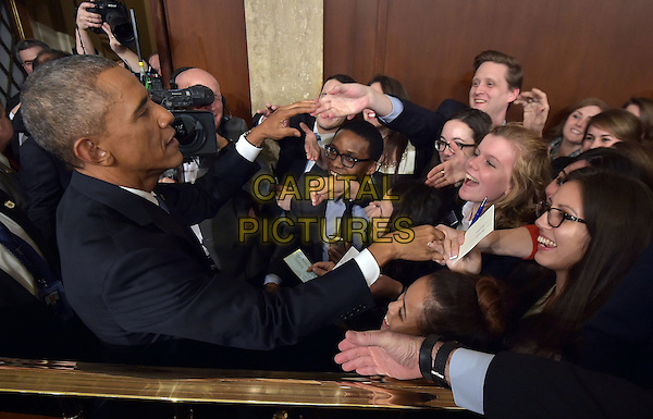 US President Barack Obama shakes hands after delivering the State of the Union address before a joint session of Congress on January 20, 2015 at the US Capitol in Washington, DC.  <br /> CAP/MPI/MAN<br /> &copy;MAN/MPI/Capital Pictures