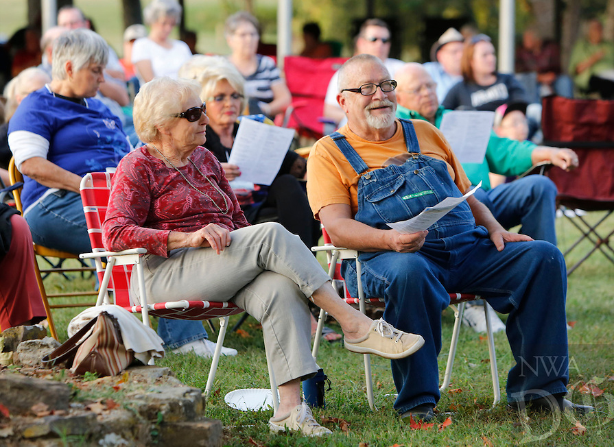 NWA Democrat-Gazette/DAVID GOTTSCHALK  Rachel and Norman Traxler listen to music Monday, September 28, 2015 during Gather at the River, a celebration at Bunch Park in Elkins. The event took place over three nights sharing a message, music and community.