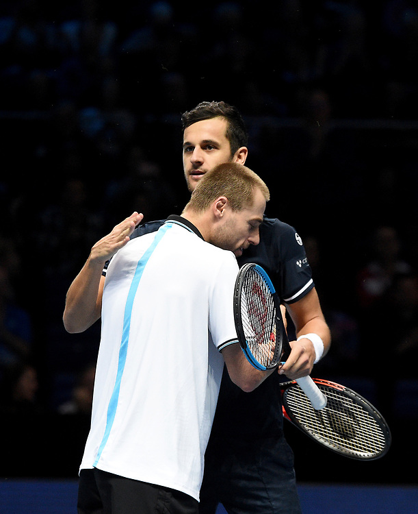 Mate Pavic and Oliver Marach celebrate winning against Pierre-Hugues Herbert and Nicolas Mahut<br /> <br /> Photographer Hannah Fountain/CameraSport<br /> <br /> International Tennis - Nitto ATP World Tour Finals Day 2 - O2 Arena - London - Monday 12th November 2018<br /> <br /> World Copyright © 2018 CameraSport. All rights reserved. 43 Linden Ave. Countesthorpe. Leicester. England. LE8 5PG - Tel: +44 (0) 116 277 4147 - admin@camerasport.com - www.camerasport.com