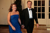 "Governor William ""Bill"" Haslam of Tennessee, right, and Crissy Haslam arrive to a state dinner hosted by U.S. President Barack Obama and U.S. First Lady Michelle Obama in honor of French President Francois Hollande at the White House in Washington, D.C., U.S., on Tuesday, Feb. 11, 2014. Obama and Hollande said the U.S. and France are embarking on a new, elevated level of cooperation as they confront global security threats in Syria and Iran, deal with climate change and expand economic cooperation.<br /> Credit: Andrew Harrer / Pool via CNP"