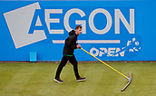 June 12th 2017,  Nottingham, England; WTA Aegon Nottingham Open Tennis Tournament day 3; A groundsman uses a mop to clear some surface moisture during the match between Broady and Marchenko