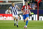 Atletico de Madrid's Diego Godin (r) and Real Sociedad's Sergio Canales during La Liga match. April 4,2017. (ALTERPHOTOS/Acero)