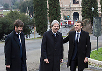 From left, Italian Culture Minister Dario Franceschini, Premier Paolo Gentiloni and French President Emmanuel Macron arrive for a visit at the Domus Aurea in Rome, January 11, 2018. In background, the Colosseum is seen.<br /> UPDATE IMAGES PRESS/Riccardo De Luca<br /> ITALY OUT