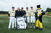 Former Wake Forest Athletic Director Ron Wellman (left) is presented with a framed jersey prior to the game against the Miami Hurricanes at David F. Couch Ballpark on May 11, 2019 in  Winston-Salem, North Carolina. The Hurricanes defeated the Demon Deacons 8-4. (Brian Westerholt/Four Seam Images)