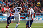 Atletico de Madrid´s Tiago Cardoso (L) and Deportivo de la Coruña´s Wilk during 2014-15 La Liga match between Atletico de Madrid and Deportivo de la Coruña at Vicente Calderon stadium in Madrid, Spain. November 30, 2014. (ALTERPHOTOS/Victor Blanco)
