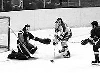 Seals Gary Jarrett scores against goalie Roy Edwards (1971 photo/Ron Riesterer)
