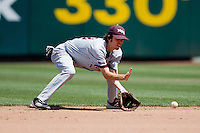 Kevin Medrano (13) of the Missouri State Bears fields a ground ball during a game against the Wichita State Shockers in the 2012 Missouri Valley Conference Championship Tournament at Hammons Field on May 23, 2012 in Springfield, Missouri. (David Welker/Four Seam Images).