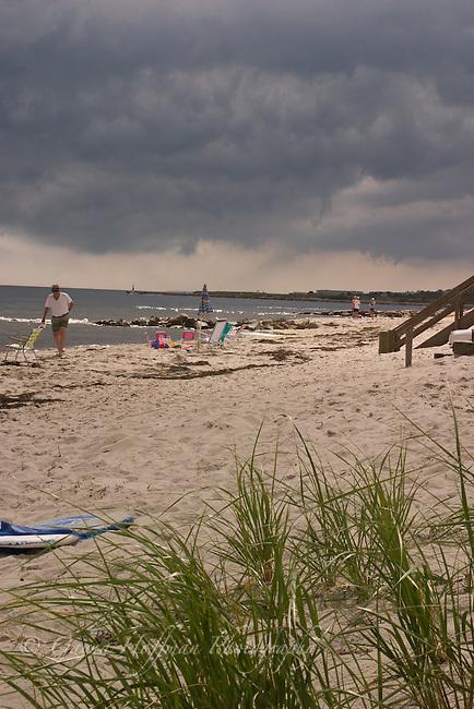 Dark storm clouds over beach.