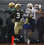 Lake Oswego's Micah Hatfield juggles the ball before making a catch for a touchdown by Jesuit defender (3 Austin Cheek in the second half in the semifinals at PGE Park November 28, 2008.