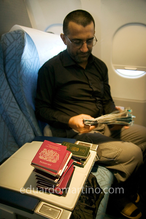Mohammed Ramzanali, group leader, organising passports and tickets from members of the group, on the way to Damascus, Syria, 26.02.04