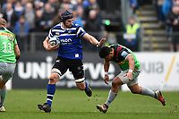 Paul Grant of Bath Rugby looks to fend Ben Tapuai of Harlequins. Gallagher Premiership match, between Bath Rugby and Harlequins on March 2, 2019 at the Recreation Ground in Bath, England. Photo by: Patrick Khachfe / Onside Images