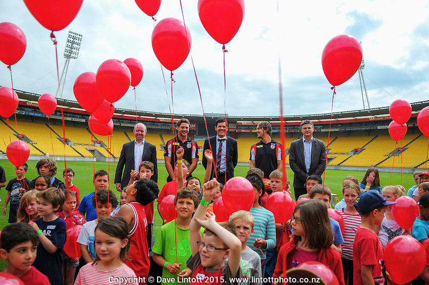 Kids wait to release the balloons at the AFL celebration of 100 day countdown until the ANZAC Centenary at Westpac Stadium, Wellington, New Zealand on Wednesday, 15 January 2015. Photo: Dave Lintott / lintottphoto.co.nz