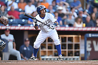 Durham Bulls third baseman Ray Olmedo #13 pops up a bunt bunt during a game against the Toledo Mud Hens at Durham Bulls Athletic Park on July 25, 2014 in Durham, North Carolina. The Mud Hens defeated the Bulls 5-3. (Tony Farlow/Four Seam Images)