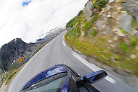 blue car drives along mountain road, Norway