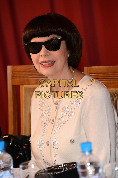 Mireille Mathieu.Press conference, National Hotel, Moscow, Russia..1st November 2012.headshot portrait white top sunglasses shades  half length.CAP/PER/AL.© AL/Persona/CapitalPictures