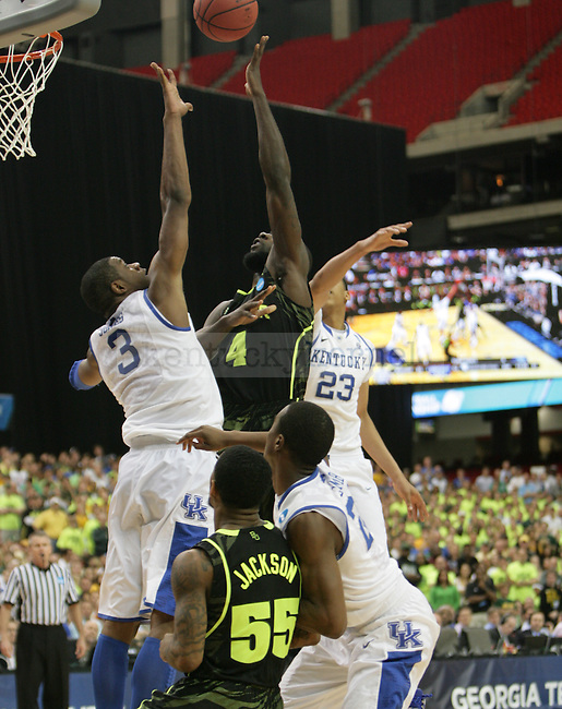 UK players defend Baylor's Quincy Acy's shot during the second half of the UK vs. Baylor South Regional Finals at the Georgia Dome in Atlanta,  March 25, 2012. UK defeated Baylor 82-70. Photo by Brandon Goodwin | Staff