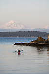 San Juan Islands, Sea kayaker, Mount Baker, Clark Island Marine State Park, Salish Sea, Washington State, Pacific Northwest, U.S.A., woman paddler, released,.