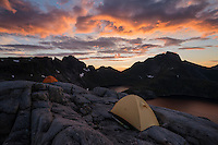 Tents pitched on rocky terrain near summit of Moldtind mountain peak, Moskenesøy, Lofoten Islands, Norway