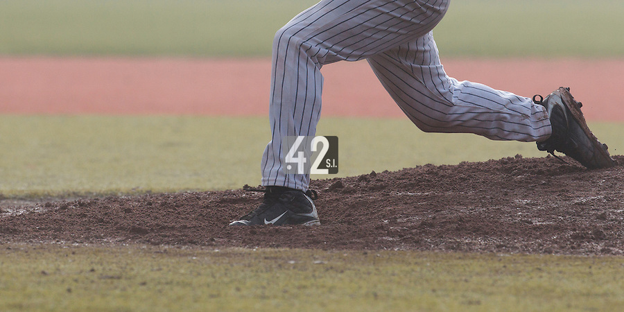 24 October 2010: View of the mound and pitcher legs in the fog during Savigny 8-7 win (in 12 innings) over Rouen, during game 3 of the French championship finals, in Rouen, France.