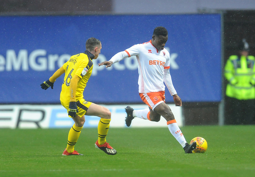Blackpool's Marc Bola under pressure from Oxford United's Gavin Whyte<br /> <br /> Photographer Kevin Barnes/CameraSport<br /> <br /> The EFL Sky Bet League One - Oxford United v Blackpool - Saturday 15th December 2018 - Kassam Stadium - Oxford<br /> <br /> World Copyright © 2018 CameraSport. All rights reserved. 43 Linden Ave. Countesthorpe. Leicester. England. LE8 5PG - Tel: +44 (0) 116 277 4147 - admin@camerasport.com - www.camerasport.com