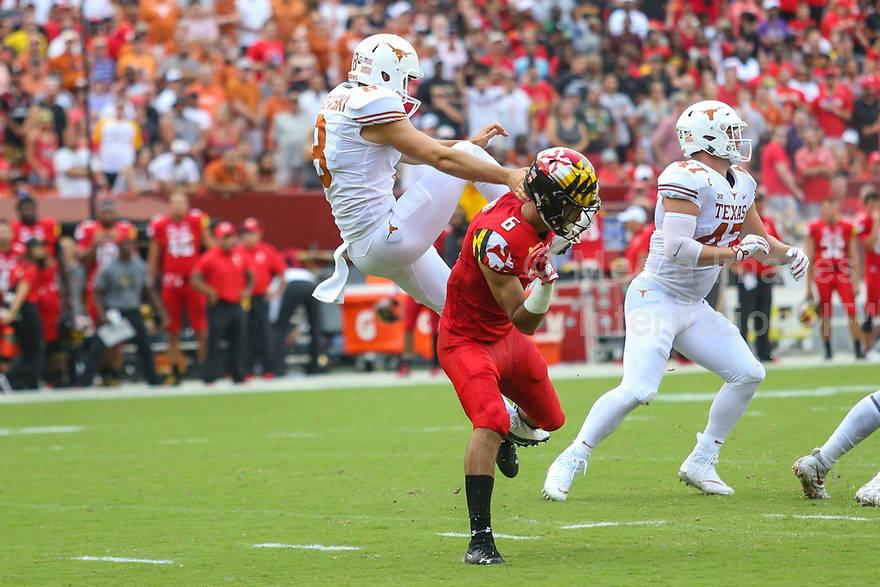 Landover, MD - September 1, 2018: Maryland Terrapins wide receiver Jeshaun Jones (6) runs into Texas Longhorns punter Ryan Bujcevski (8) during the game between Texas and Maryland at  FedEx Field in Landover, MD.  (Photo by Elliott Brown/Media Images International)