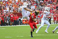 Landover, MD - September 1, 2018: Maryland Terrapins wide receiver Jeshaun Jones (6) runs into Texas Longhorns punter Ryan Bujcevski (8) during the game between Texas and Maryland at  FedEx Field in Landover, MD.  (Photo by Elliott Brown/Media Images International)