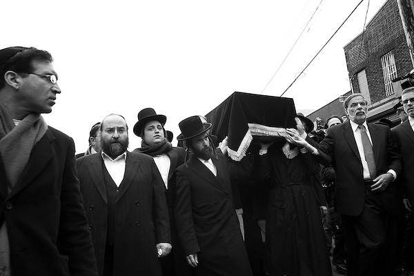 Wednesday, April 18,  2007, Brooklyn, New York..A funeral was held in Brooklyn for Professor Librescu, a holocaust survivor and teacher at Virginia Tech, who was killed in the shootings on Monday.. Mourners carry the casket of Prof. Librescu to the car which will the body to the airport and then to Israel for burial.