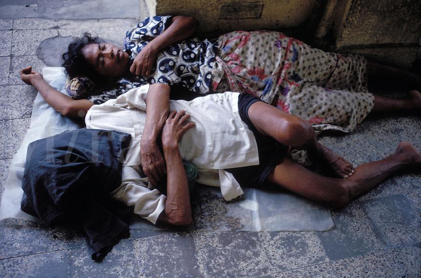 Sleeping homeless.