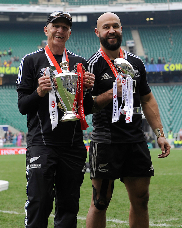 Gordon Tietjens, New Zealand Sevens Head Coach, and New Zealand captain DJ Forbes with the HSBC Sevens Series trophy and the Marriott London Sevens trophy during Day Two of the iRB Marriott London Sevens at Twickenham on Sunday 11th May 2014 (Photo by Rob Munro)