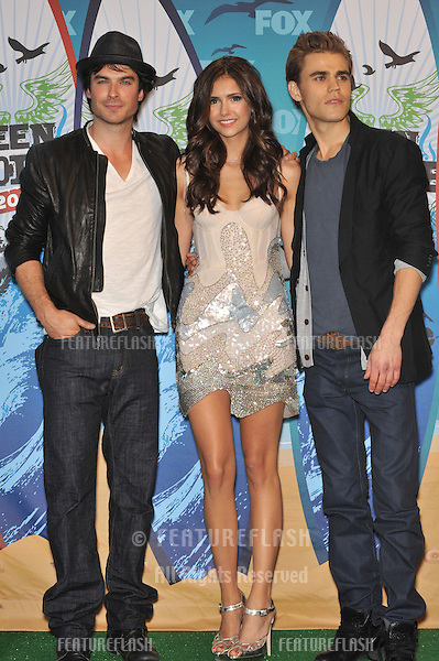 Vampire Diaries stars Ian Somerhalder (left), Nina Dobrev & Paul Wesley at the 2010 Teen Choice Awards at the Gibson Amphitheatre, Universal Studios, Hollywood, CA..August 8, 2010  Los Angeles, CA.Picture: Paul Smith / Featureflash
