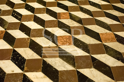 Sienna, Tuscany, Italy. An old trompe l'oeil block design floor in black brown stone and white marble.