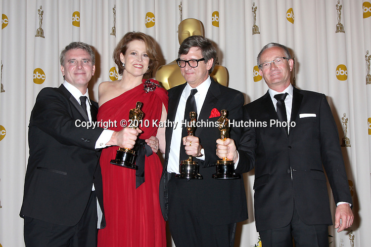 Actress Sigourney Weaver (2nd L) with art directors (L-R) Rick Carter, Robert Stromberg and Kim Sinclair, winners of Best Art Direction for 'Avatar,.in the Press Room of the 82nd Academy Awards.Kodak Theater.Los Angeles, CA.March 7, 2010.©2010 Kathy Hutchins / Hutchins Photo....