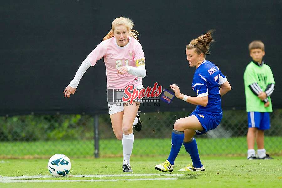 Jackie Logue (21) of the Wake Forest Demon Deacons keeps the ball away from Whitney Berry (7) of the Kansas Jayhawks at Spry Soccer Stadium on October 7, 2012 in Winston-Salem, North Carolina.  The Demon Deacons and the Jayhawks battled to a 1-1 tie in double overtime.  (Brian Westerholt/Sports On Film)