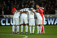 Swansea players huddle before the Barclays Premier League match between Swansea City and Leicester City at the Liberty Stadium, Swansea on December 05 2015