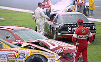 An early race crash litters the frontstretch with wrecked race cars at the Pepsi 400 at Daytona International Speedway, Daytona Beach, FL, July 7, 1990 (Photo by Brian Cleary/www.bcpix.com)