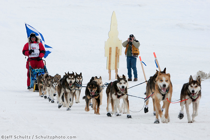 Scottish musher Wattie McDonald mushes up the seawall from the Bering Sea onto Front Street in Nome during the 2010 Iditarod