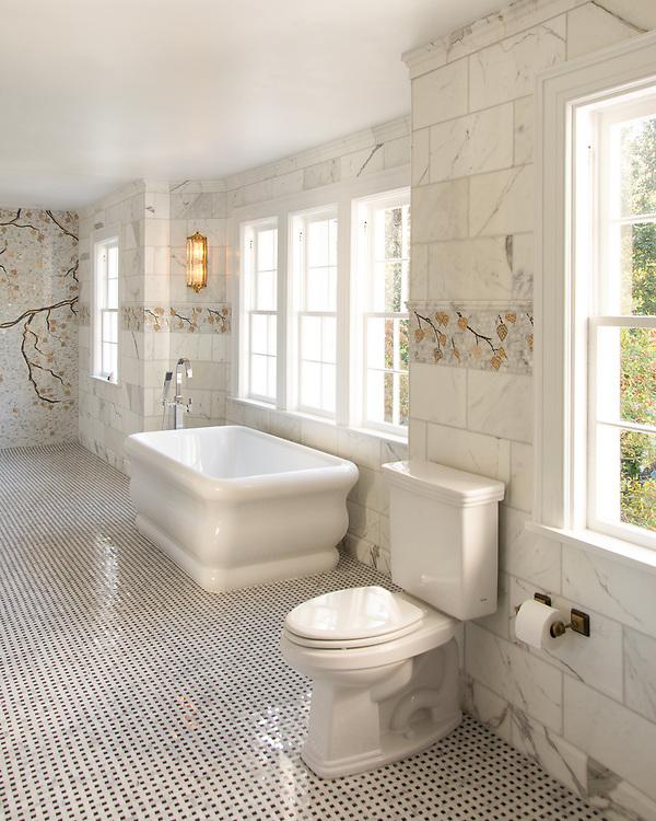 Aspen, a hand-cut stone mosaic, shown in polished Calacatta Tia, Saint Laurant, Persian Gold and Sylvia Gold with 24K Gold Glass.<br /> Bathroom design by Geraldine Eisenberg of Aiken, SC <br /> Tile sourced through Renaissance Tile & Bath Charlotte, NC