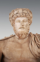 Roman sculpture of the Emperor Lucius Verus, excavated from Bulla Regia Theatre, sculpted circa 161-169 AD. The Bardo National Museum, Tunis.   Against a grey background.