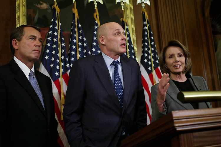"""WASHINGTON, DC - Jan. 24: House Minority Leader John A. Boehner, R-Ohio, Treasury Secretary Henry M. Paulson Jr. and House Speaker Nancy Pelosi, D-Calif., during a news conference announcing that House leaders and the Bush administration reached a compromise economic stimulus package Thursday built around rebates for most taxpayers and incentives for business investment. The measure, estimated at $150 billion, also would make it easier for homeowners to refinance their adjustable-rate mortgage loans into fixed-rate mortgages insured by the Federal Housing Administration. House Speaker Nancy Pelosi, D-Calif., and Minority Leader John A. Boehner, R-Ohio, called on members of their respective caucuses to line up behind the package so it can quickly be passed by the House and sent to the Senate. President Bush added his encouragement. """"Because the country needs this boost to the economy now, I urge the House and the Senate to enact this economic growth agreement into law as soon as possible,"""" he said. (Photo by Scott J. Ferrell/Congressional Quarterly)"""