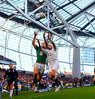 01.03.2015.  Dublin, Ireland. 6 Nations International Rubgy Championship. Ireland versus England.<br /> Robbie Henshaw (Ireland) and Alex Goode (England) challenge in the air for the ball.
