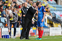 Andrew Hughes of Peterborough United (right) takes instruction from Grant McCann (Manager) of Peterborough United during the Sky Bet League 1 match between Peterborough and Oxford United at the ABAX Stadium, London Road, Peterborough, England on 30 September 2017. Photo by David Horn.