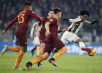 Calcio, Serie A: Juventus vs Roma. Torino, Juventus Stadium,17 dicembre 2016. <br /> Juventus' Juan Cuadrado, right, is challenged by Roma&rsquo;s Stephan El Shaarawy, center, and Emerson Palmieri, during the Italian Serie A football match between Juventus and Roma at Turin's Juventus Stadium, 17 December 2016.<br /> UPDATE IMAGES PRESS/Isabella Bonotto