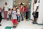 September 14, 2011. Raleigh, NC. . Kids  and parents line up outside the classroom for the 8:30 arrival time.. Project Enlightenment, a public pre-kindergarten program for at risk children, has been threatened with closure due to state wide budget cuts..