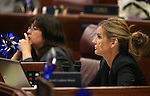 Nevada Assemblywomen Irene Bustamante-Adams, D-Las Vegas, left, and Melissa Woodbury, R-Las Vegas, work on the Assembly floor at the Legislative Building in Carson City, Nev., on Sunday, June 2, 2013. <br /> Photo by Cathleen Allison