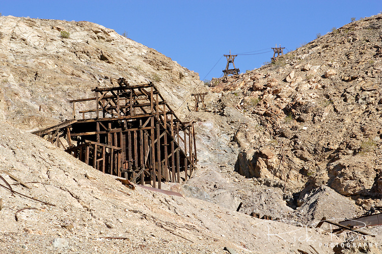 Keane Wonder Mine stamp mill in Death Valley National Park. The Keane Wonder mine was one of the two largest producing gold mines in the Death Valley area. The total production of the mine during its operation was estimated at $1,100,000. Of that amount, $625,000-$682,000 worth of gold was taken from the mine between 1907-1911.