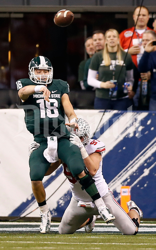 Ohio State Buckeyes defensive lineman Joey Bosa (97) pressures Michigan State Spartans quarterback Connor Cook (18) during the second quarter of the Big Ten championship football game at Lucas Oil Stadium in Indianapolis on Dec. 7, 2013. (Adam Cairns / The Columbus Dispatch)