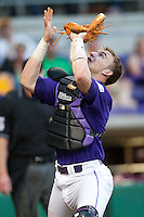 LSU Tigers catcher Ty Ross #26 catches a foul pop against the Mississippi State Bulldogs during the NCAA baseball game on March 17, 2012 at Alex Box Stadium in Baton Rouge, Louisiana. The 10th-ranked LSU Tigers beat #21 Mississippi State, 4-3. (Andrew Woolley / Four Seam Images).