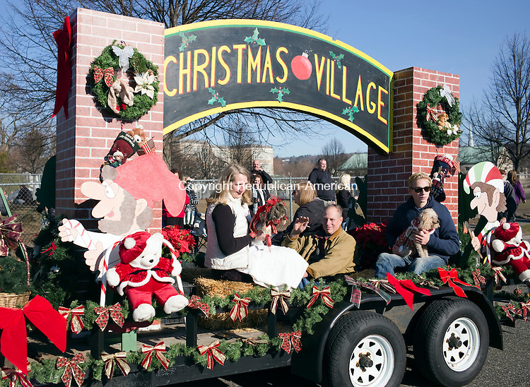 Torrington, CT- 06 December 2015-120615CM05-  A Christmas Village float makes it's away along the parade route during the annual Torrington Christmas parade on Sunday. The event kicked off the opening of town's 68th year of the Christmas Village.   Christopher Massa Republican-American
